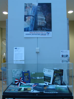 Depository poster and a selection of Federal government publications from 2000-2007