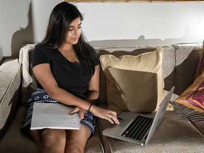 Student Looking at Laptop from Home