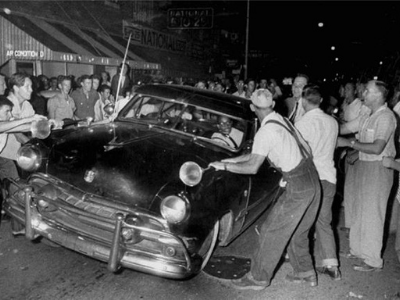 Archived Image of Men Surrounding Car of Black American